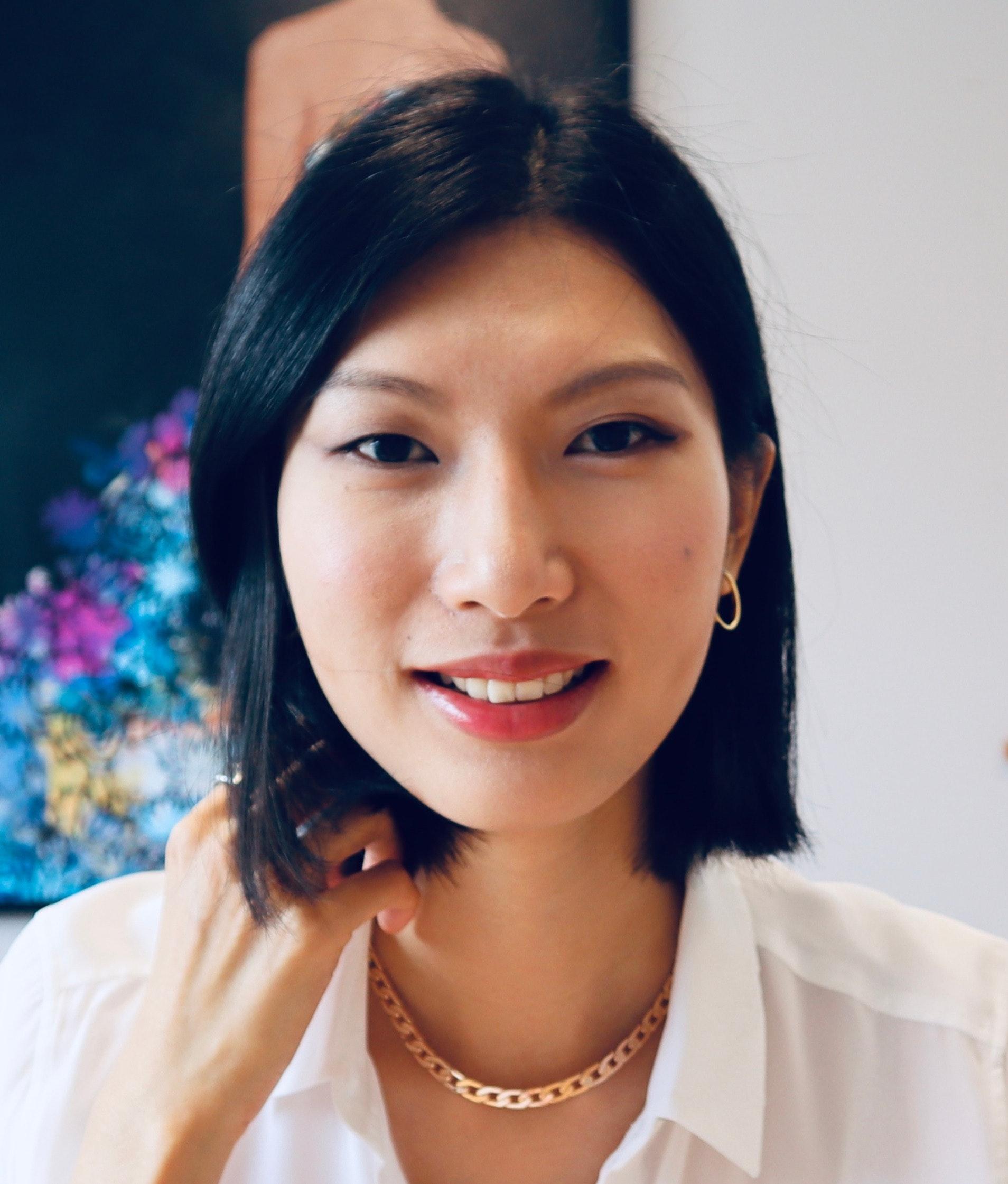 Yumin  Tan